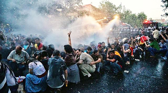 Police deploy water cannons on June 23 to disperse protesters demanding an end to electricity price hikes