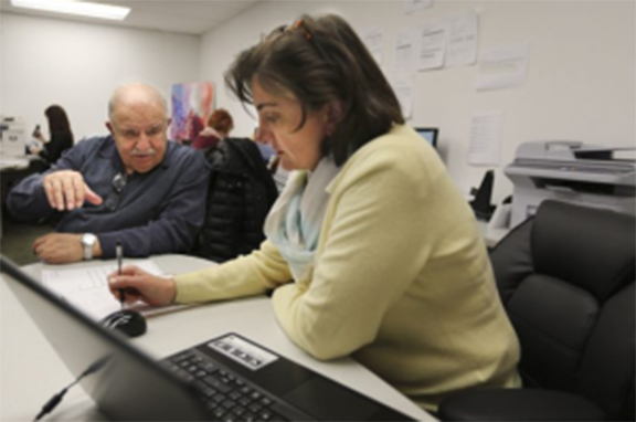 The phones ring continuously at the Armenian Community Center of Toronto SAH office. (Photo: Toronto Star)
