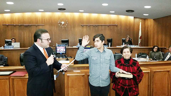 Alex Manoukian being sworn in as commissioner by Mesrobian alumnus and Montebello City Council member Jack Hadjinian