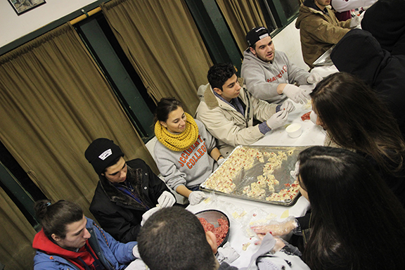 "Students preparing ""Manteh"" during one of their activities at the retreat."