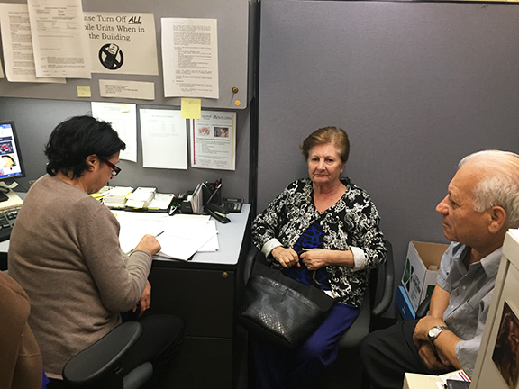 Case Worker Mimi Eskandarian conducts case management and assists clients in completing forms