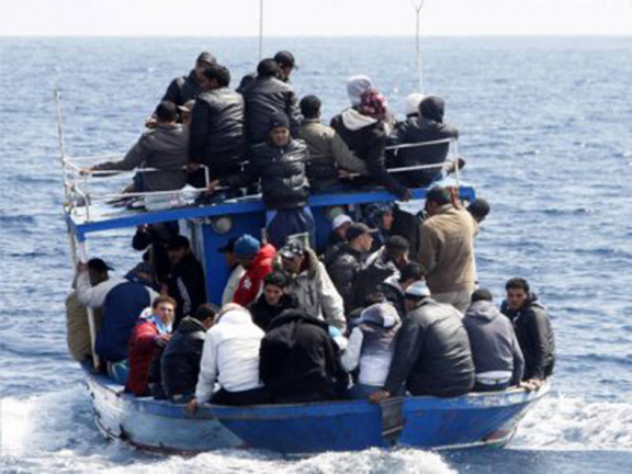 Refugees aboard a boat making their way to Europe. (Source: New.am)