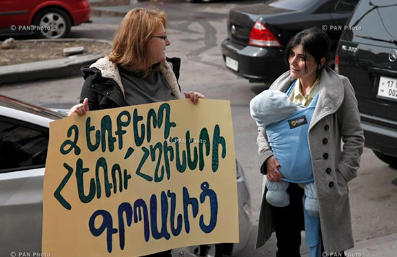 'Just a few years ago, the government tried to abolish paid maternity leave and free vaccinations for infants. Luckily, women's rights activists were able to retract those decisions through vigorous protesting.' (Source: PanArmenian Photo)