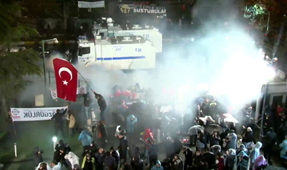 The Turkish police raiding the Zaman headquarters and pepper spraying those who were standing outside it. (Source: Today's Zaman)