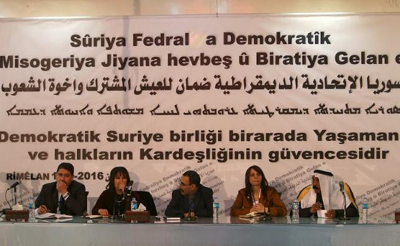 Bureau members of a preparatory conference to announce a federal system discuss a 'Democratic Federal System for Rojava - Northern Syria' in the Kurdish-controlled town of Rmeilan, Hasaka province, Syria March 16, 2016. (Source: Reuters/Rodi Said)