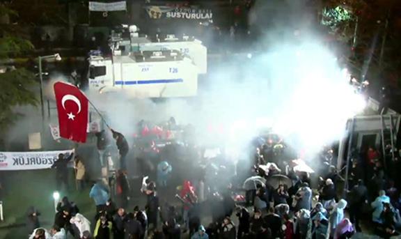 Turkish police raiding crowds outside Zaman Headquarters and spraying them with tear gas. (Source: Today's Zaman)