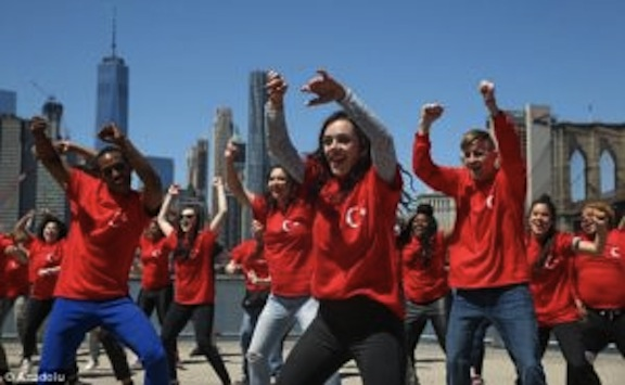 "A young dance group donning t-shirts of the Turkish flag and the phrase ""Truth = Peace"" performing in Brooklyn (Photo: Anadolu)"