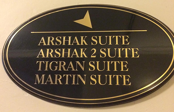 A sign noting the names of the suites named after hotel founders Arshak, Tigran and Martin.