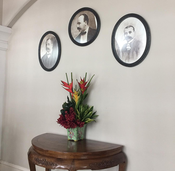 Sarkies brothers' photos hanging on the hotel wall