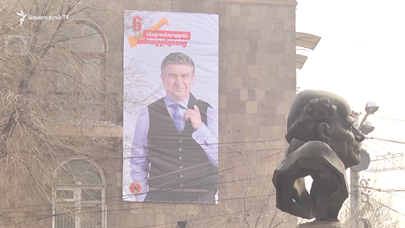 Election posters and banners of the ruling RPA have sprung up across Yerevan, days ahead of the official kick-off of campaigning for the upcoming Parliamentary elections, causing quite a stir. (Photo: RFE/RL Armenian Service TV)