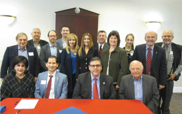 (Seated, from left to right) Jane Bedrosian, Dean Saúl Jiménez- Sandoval, President Dr. Joseph I. Castro, Justice Marvin Baxter. (Standing, from left to right) Phil Maroot, Victor Sahatdjian, Dr. Sergio La Porta, Prof. Arakel Arisian, Jacqueline Lion, Debbie Adishian-Astone, Warren Paboojian, Shirley Melikian-Armbruster, Marine Vardanyan, Prof. Barlow Der Mugrdechian, and Kenneth Peters.