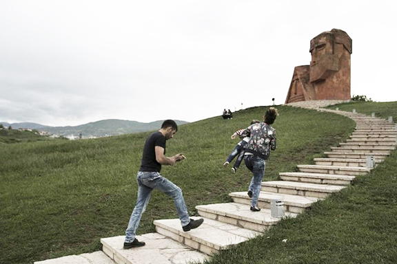 "Visitors climb the stairs to the ""We are Our Mountains"" monument in Artsakh"