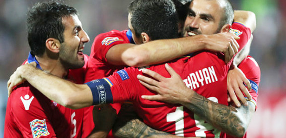 Armenia team members embrace their victory after they beat Macedonia 4-0 in a Nations League Match at Vazgen Sargsyan National Stadium
