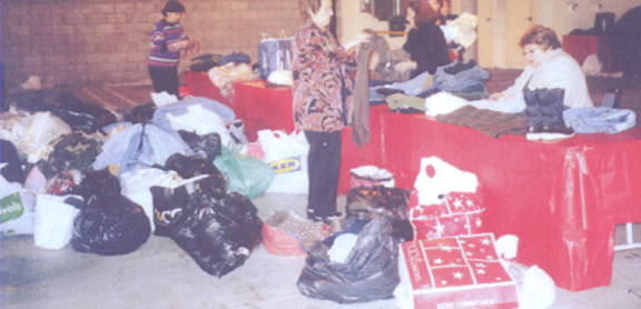 Volunteers at an Armenian center gathering clothing for the ARS relief efforts