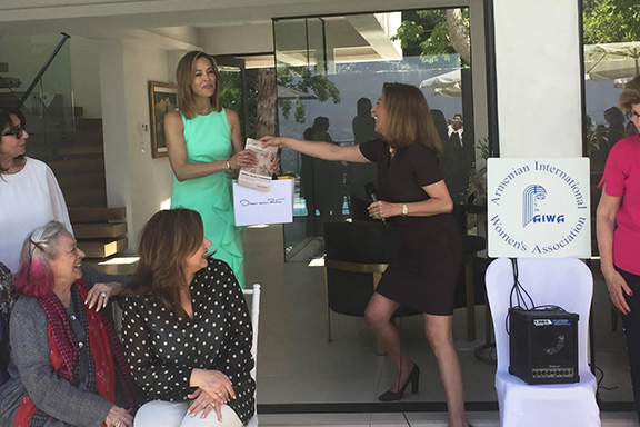 Standing from l to r: Anita Vogel, Guest Speaker, Fox TV Newscaster,with Nicole Nishanian, President of AIWA-LA