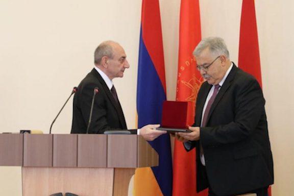 "Artsakh President Bako Sahakian presents the ""Medal of Gratitude"" to ARF Bureau chairman Hagop Der Khahcadourian"