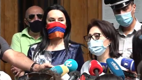 ARF Supreme Council of Armenia member Lilit Galstyan speaks to reporters on June 30