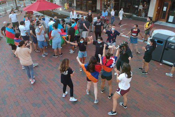 Armenian youth dancing in Harvard Square with a group of Azeri counterprotesters looking on (Photo: Vrej Ashjian)