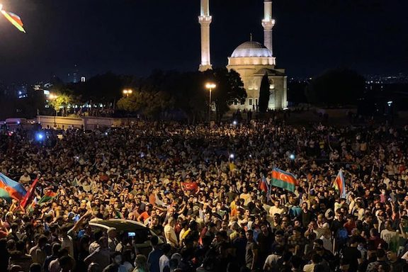 Thousands of protesters took to the streets of Baku on Tuesday demanding war with Armenia