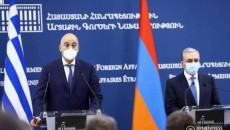 Greece's Foreign Minister Nikos Denidas at a joint press conference in Yerevan with his Armenian counterpart Zohrab Mnatsakanyan on Oct. 16