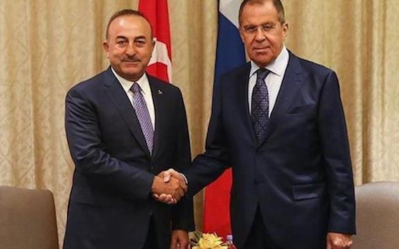Turkey's Foreign Minister Mevlut Cavusoglu (left) with his Russian counterpart Sergei Lavrov