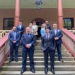 ANC Australia members and New South Wales lawmakers on the steps of the Legislative Assembly