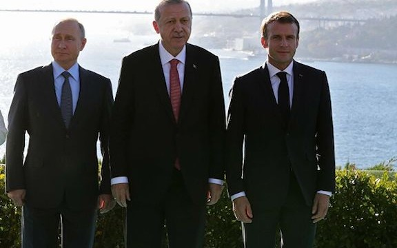 From left Russian President Vladimir Putin with his Turkish and French counterparts Recep Tayyip Erdogan and Emanuel Macron in Turkey in 2018