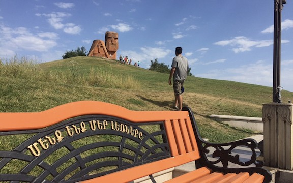 """The author, Raffi Dadaian, visiting the """"We are Our Mountains"""" monument in Artsakh"""