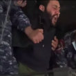 A protester is being dragged by Armenian police