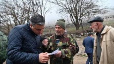 Armenia's Human Rights Defender Arman Tatoyan (left) with residents of Syunik during a fact-finding mission on Feb. 16