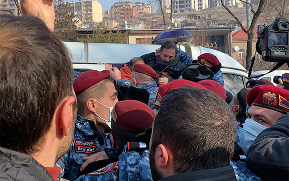 ARF leader Gegham Manukyan is seen being hauled off by national security forces