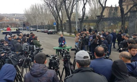 ARF leader and coordinator of the Homeland Salvation Movement Ishkhan Saghatelyan speaks to reporters on Baghramyan Avenue on March 19