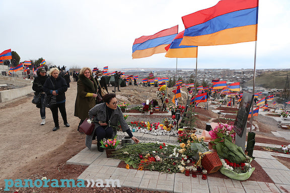 ARF Supreme Council of Armenia member Lilit Galstyan lays flowers on the graves of fallen soldiers