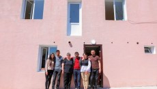 The Gabrielyans in front of their renovated home in Martuni's Herher village (Photo: Artsakhpress/Tufenkian Foundation)