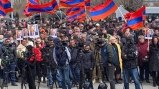 Residents of Sevan attend a rally in Sevan on April 6