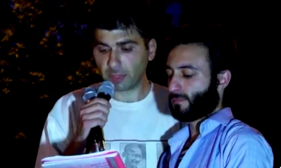 Baghramyan Ave. protest organizer Davit Sanasaryan (left) reads a statement  that includes a deadline to government