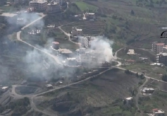 Smoke rises from building in Kessab during another attack by Turkish-backed militants in 2014