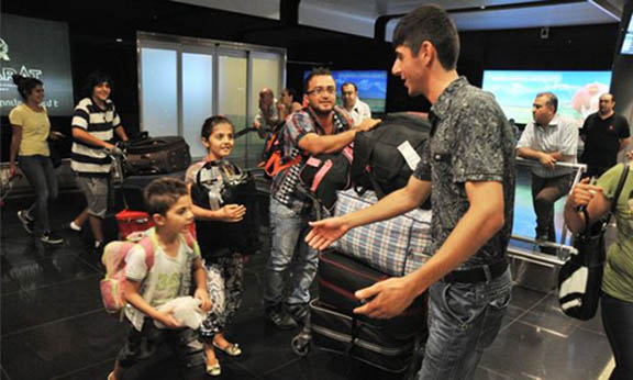 Syrian Armenian refugees arriving at Zvartnotz Airport. (Source: Getty Images)