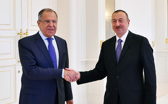 Russian Foreign Minister Sergei Lavrov meets with Azerbaijani President Ilham Aliyev on Tuesday in Baku