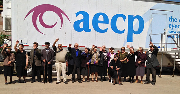 Group of patients outside the AECP Mobile Eye Hospital