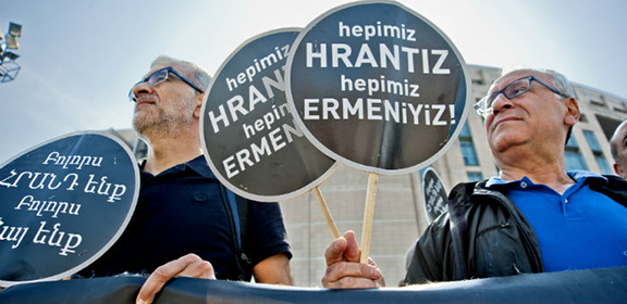"Demonstrators holding signs that read ""We are all Hrant Dink; We are all Armenian"" (Photo: Berge Arabian)"