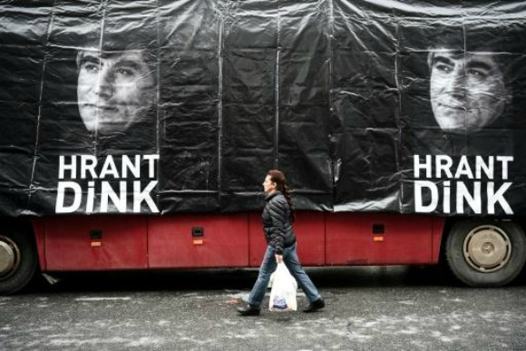 A banner shows late Turkish-Armenian journalist Hrant Dink in front of the offices of the Agos newspaper offices (Photo: AFP/Ozan Kose)