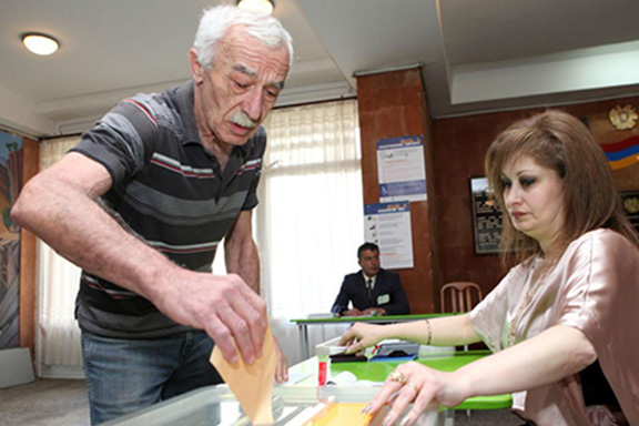 A man casts his ballot during last year's parliamentary election