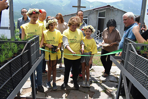 The late Charles G. Bilezikian's wife Doreen officially opens the greenhouse in Margahovit Village on June 15