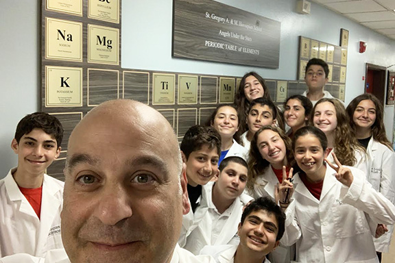Principal of Hovsepian School, Shahe Mankerian with middle school students who have been introduced to a new educational approach—STEAM