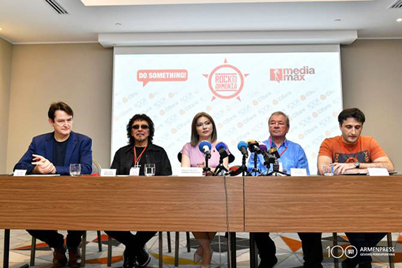 A scene from a press conference for Rock Aid Armenia's 30th Anniversary