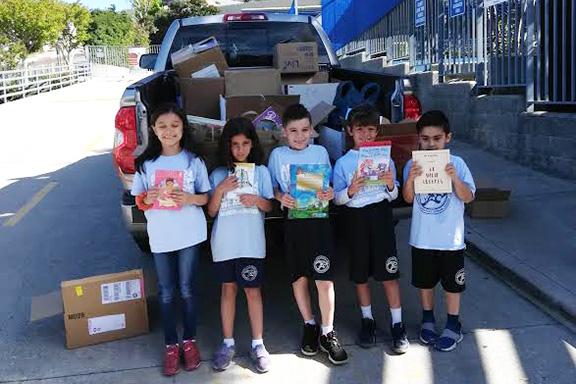 Vahan & Anoush Chamlian Armenian School students donating books to Shirvanian Youth Center, Gyumri and kindergarten and day school in Nanulik.