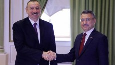 Turkey's Vice-President Fuat Oktay (right) with Azeri President Ilham Aliyev in Baku in 2019