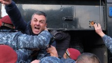 VIEW GALLERY: ARF leader Ishkhan Saghatelyan was among dozens of protesters being forcibly hauled off by Armenian police on Nov. 11