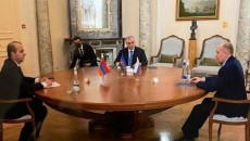 Alexander Bortnikov (right), the head of Russia's Federal Security Service, hosts a meeting of his Armenian and Azerbaijani counterparts in Moscow on Dec. 28